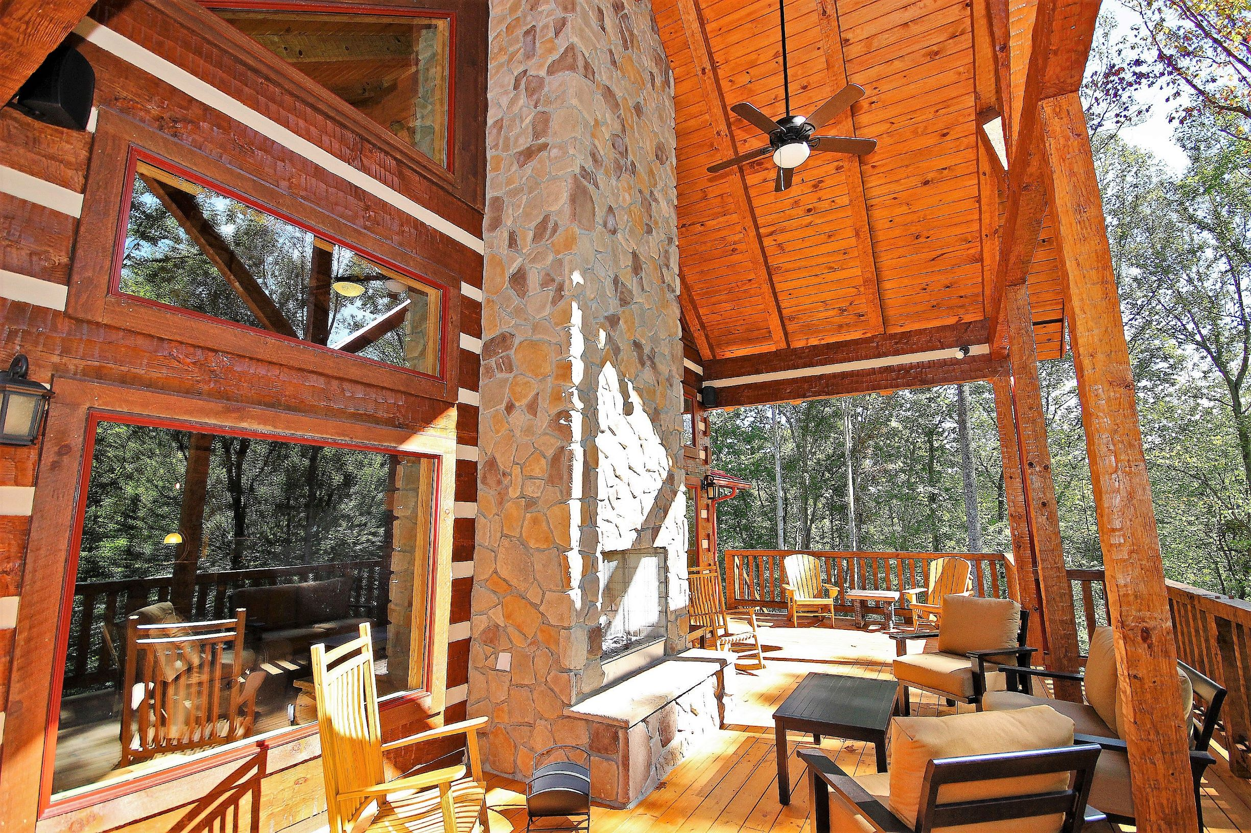 Covered Deck - Portion of expansive covered decking showing exterior wood burning fireplace.