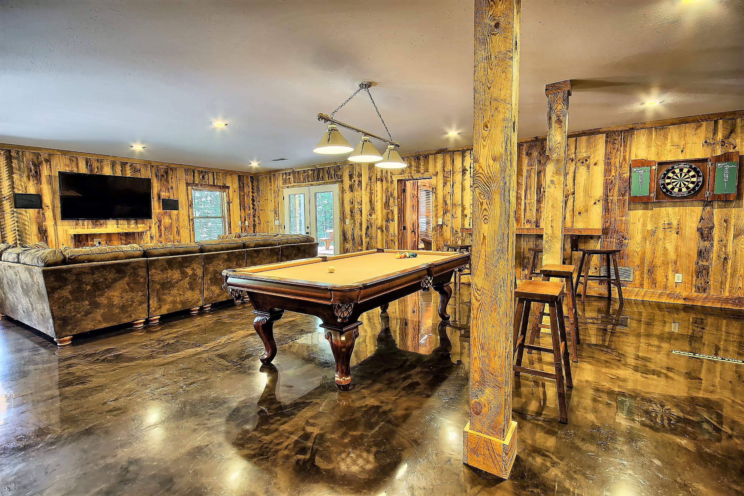 Lower Level Entertainment Room - Featuring pool table, dart board, 65 flat screen TV