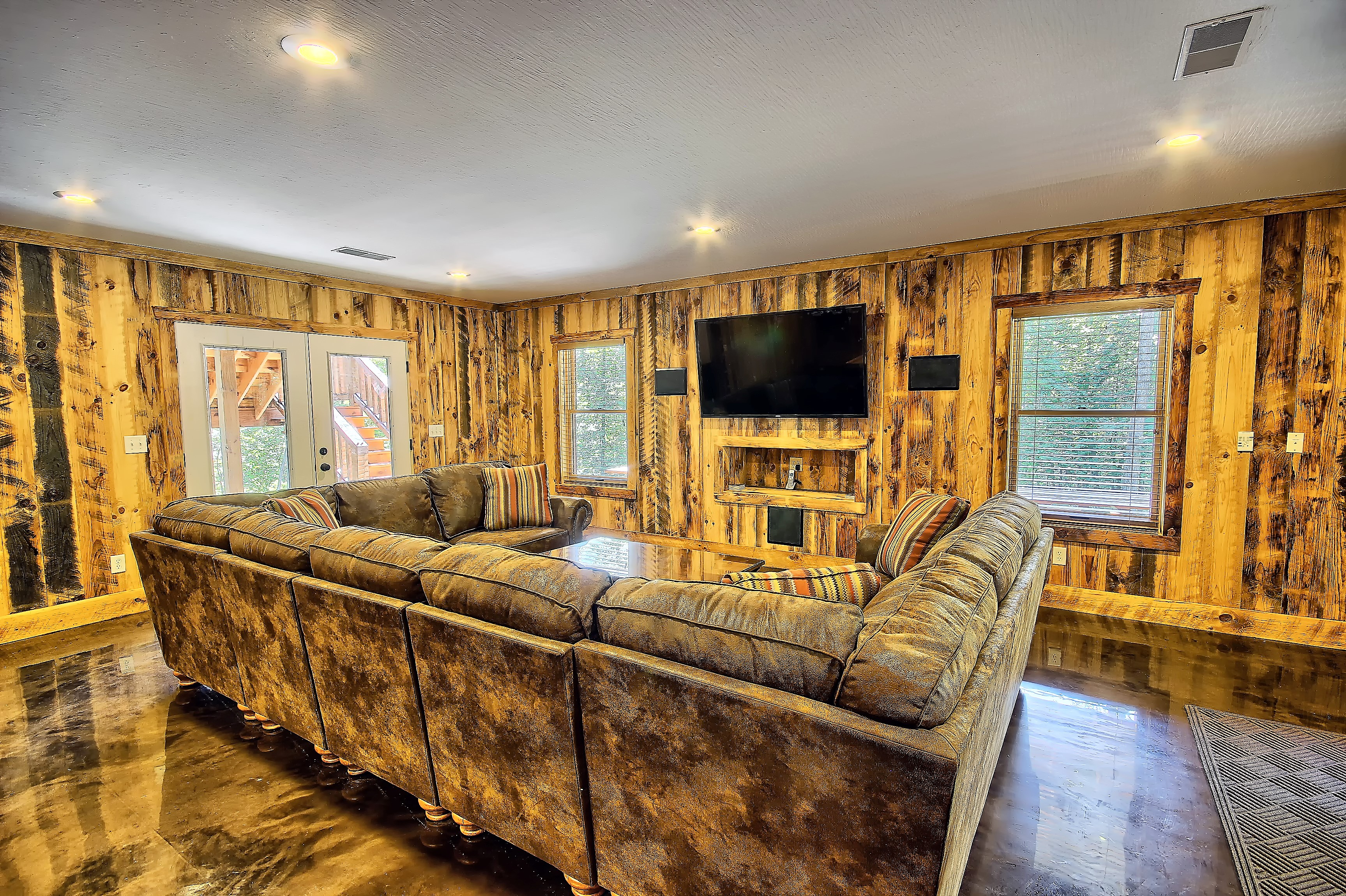 Lower Level Entertainment Room - Enjoy the game or your favorite movie on the 65 TV with professional sound system