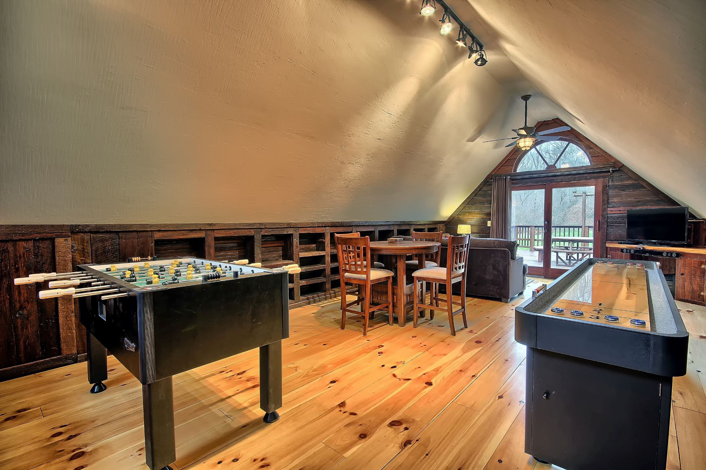 Upper Level Game Room - Features foosball, shuffle board, pub table, couch and tv with blue tooth soundbar.