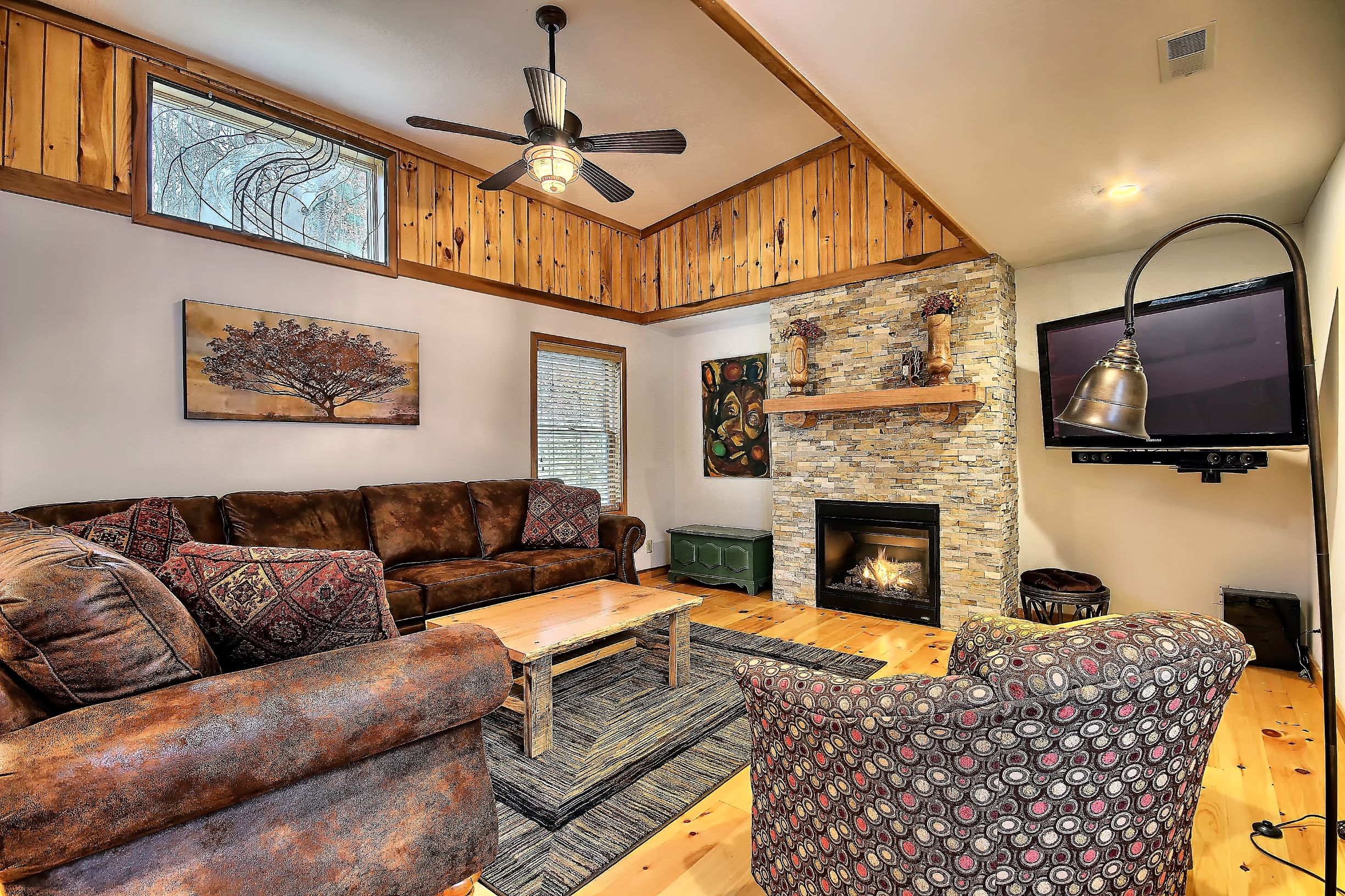 Living Room - Living area with gas fireplace and large screen smart tv with blue tooth soundbar.