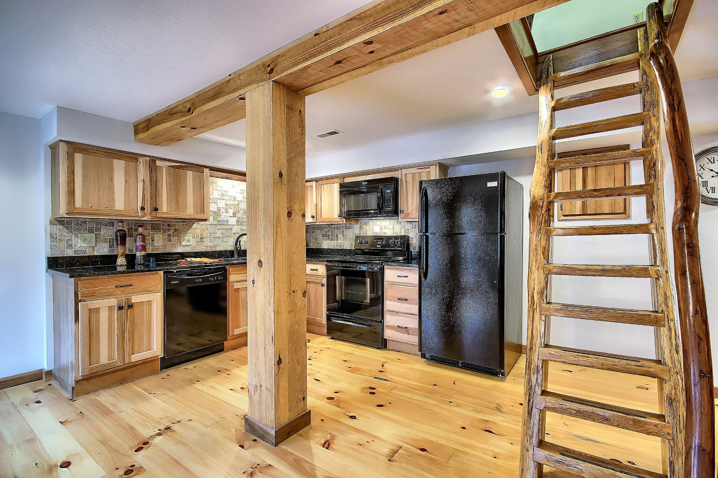 Kitchen - Open concept kicthen. Ladder staircase leads to master bedroom and full bath with soaking tub. Note other 2 bedrooms are accessed via a normal staircase.