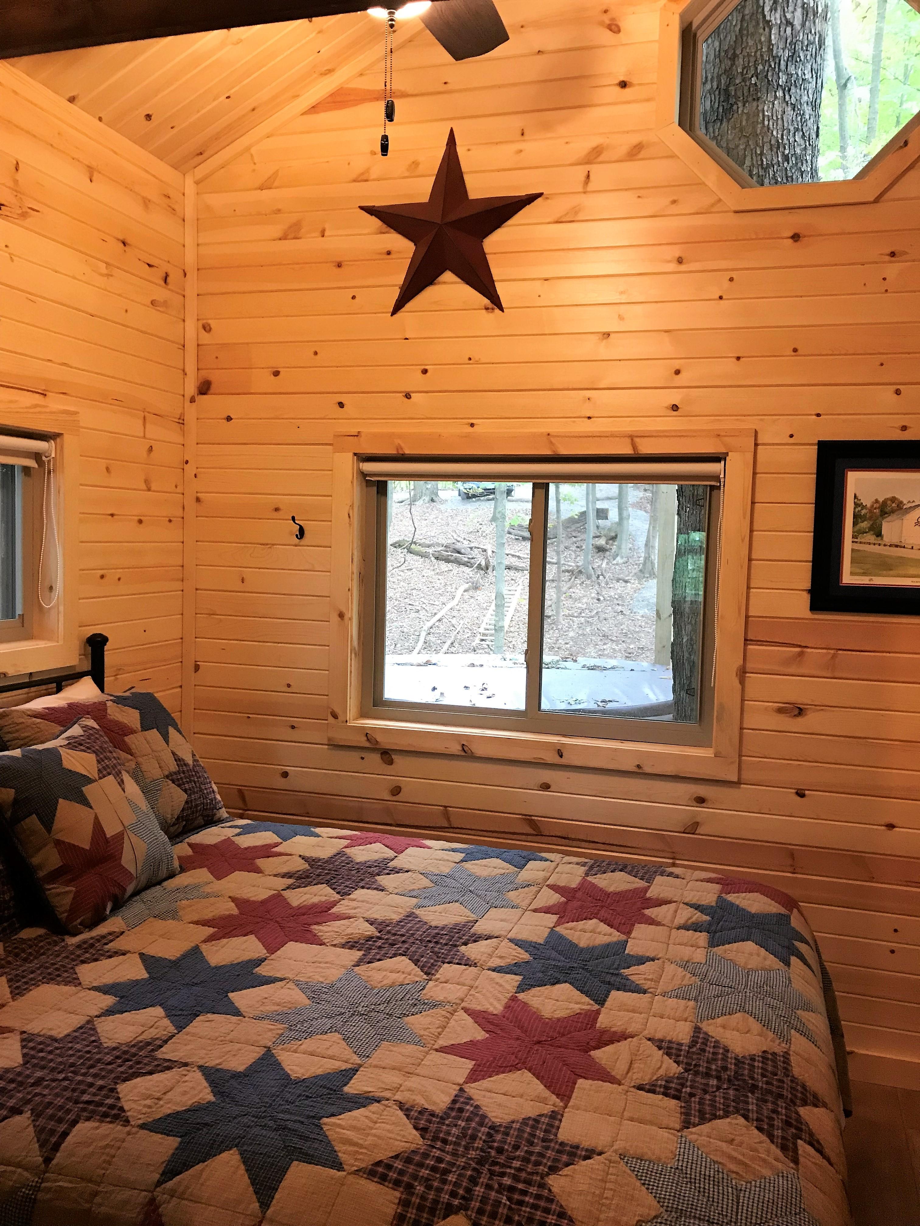 queen bedroom - Beautiful windows to wake up to.