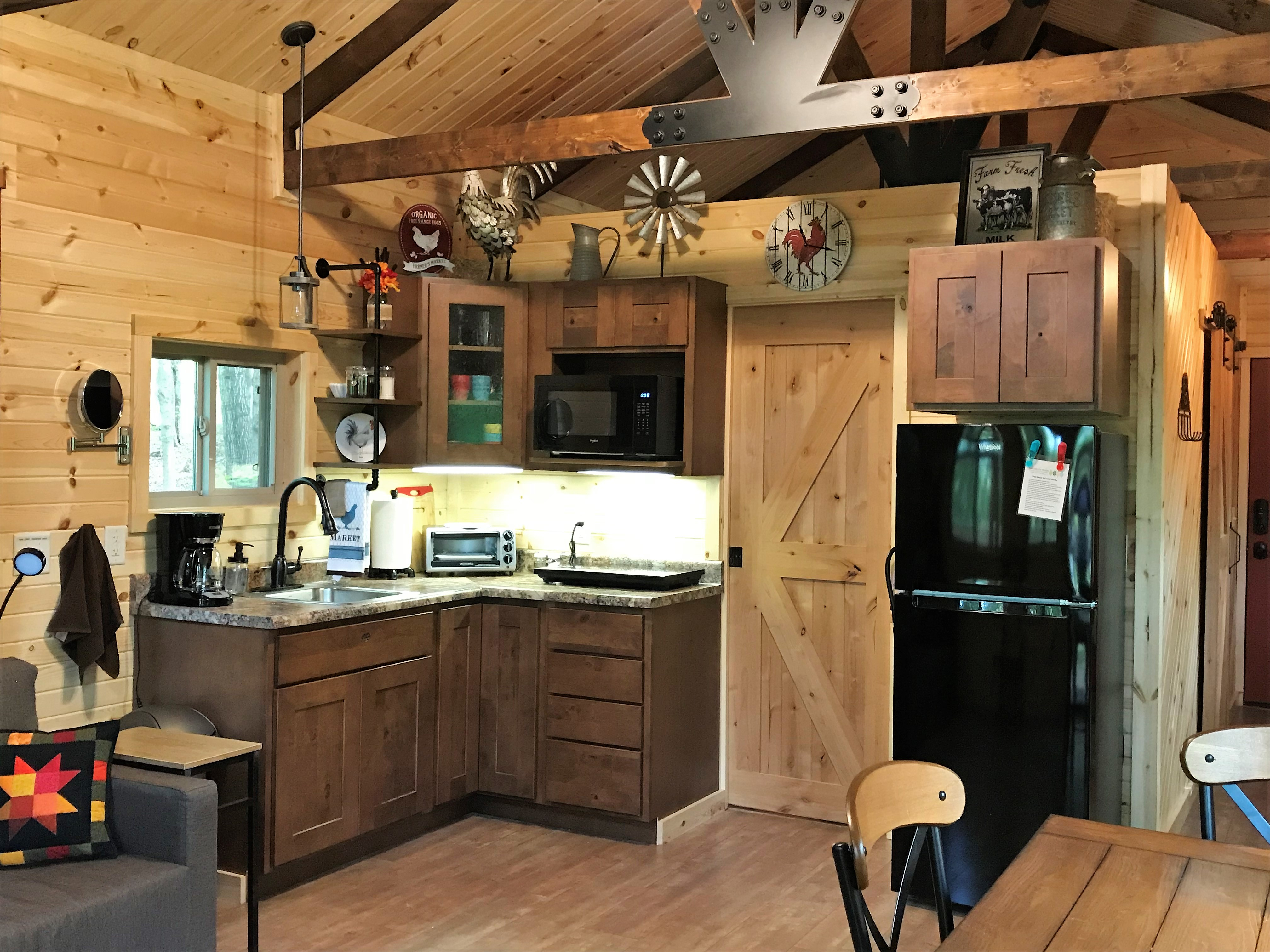kitchen area - Dishes, cookware and utensils are provided for your stay.