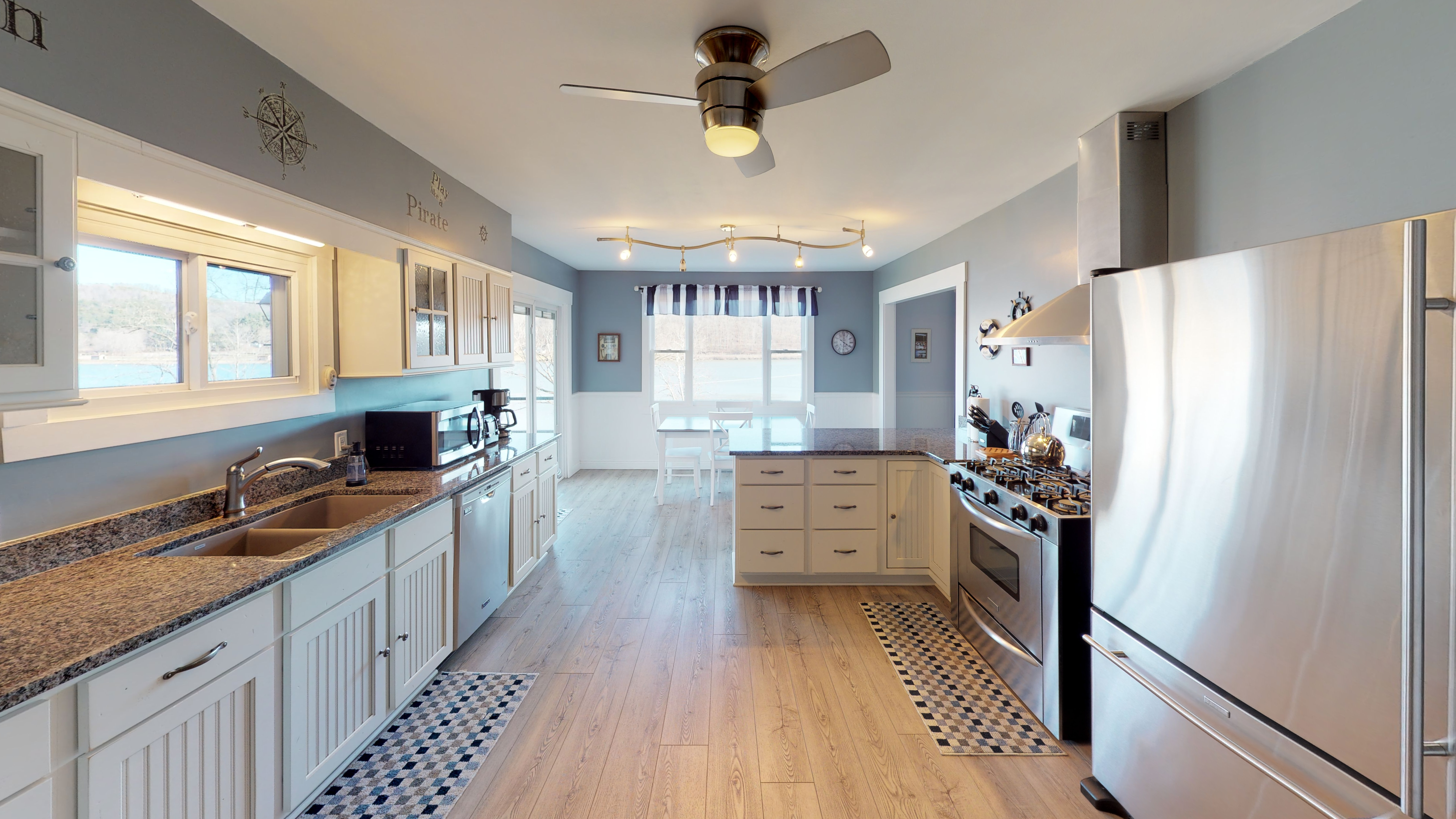Kitchen - Large, well-appointed kitchen with high end appliances and amazing views of the lake.