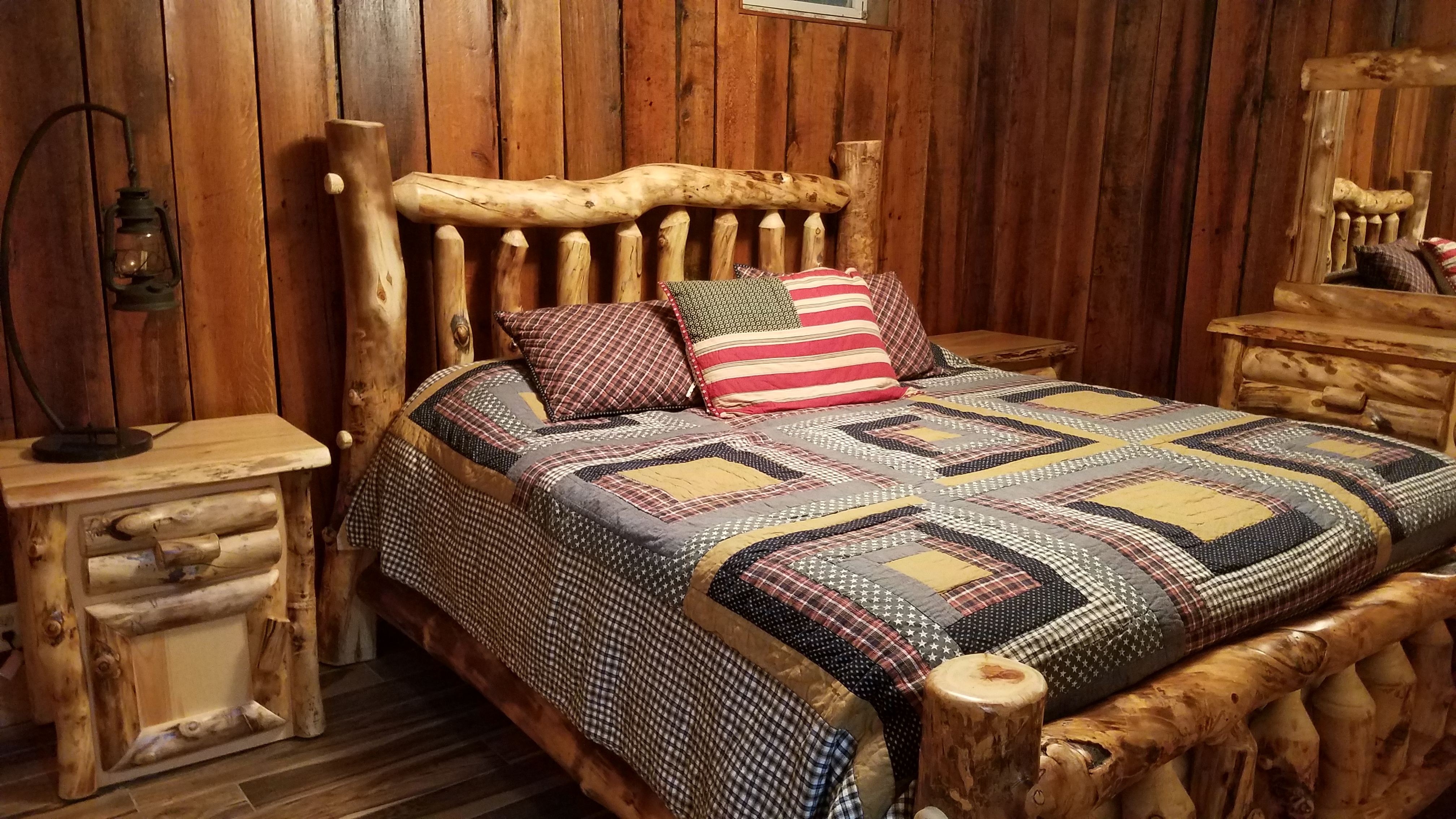 Bedroom - One of three bedrooms that features log framed bed and matching dresser and night stand.
