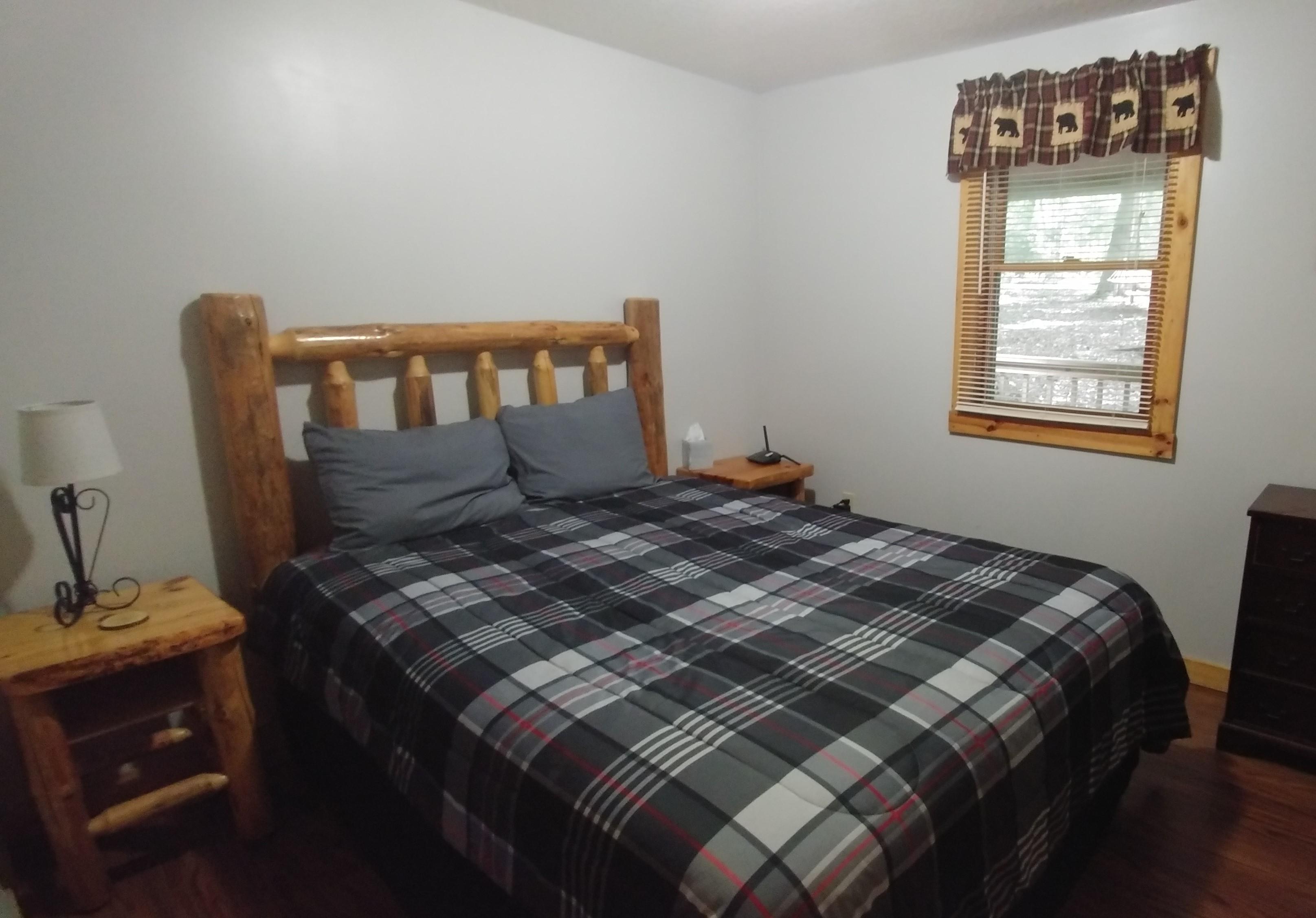 Main Floor Bedroom - Queen log bed