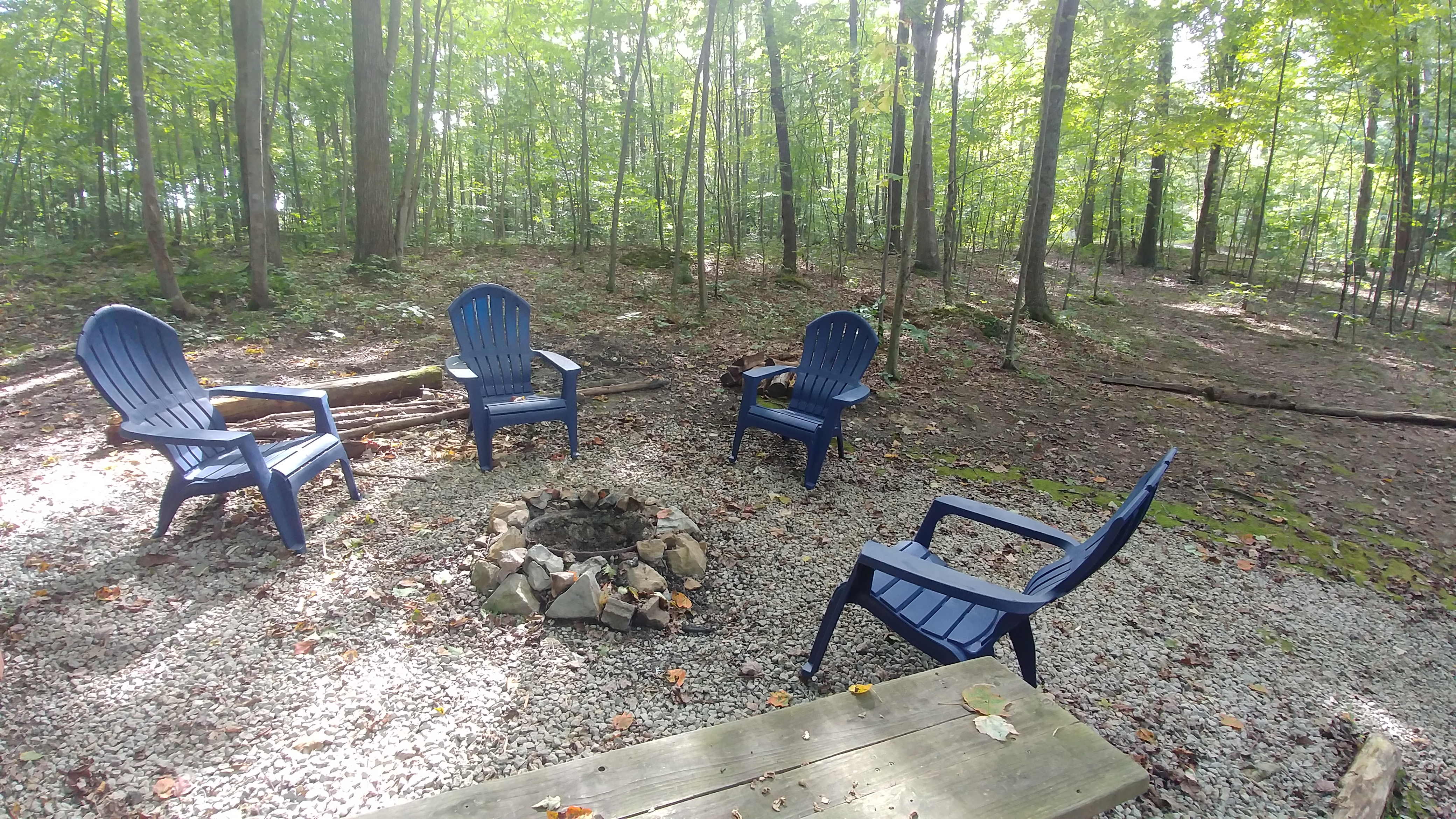 Fire Pit - The fire pit is located in our wooded surrounding, such a peaceful setting!