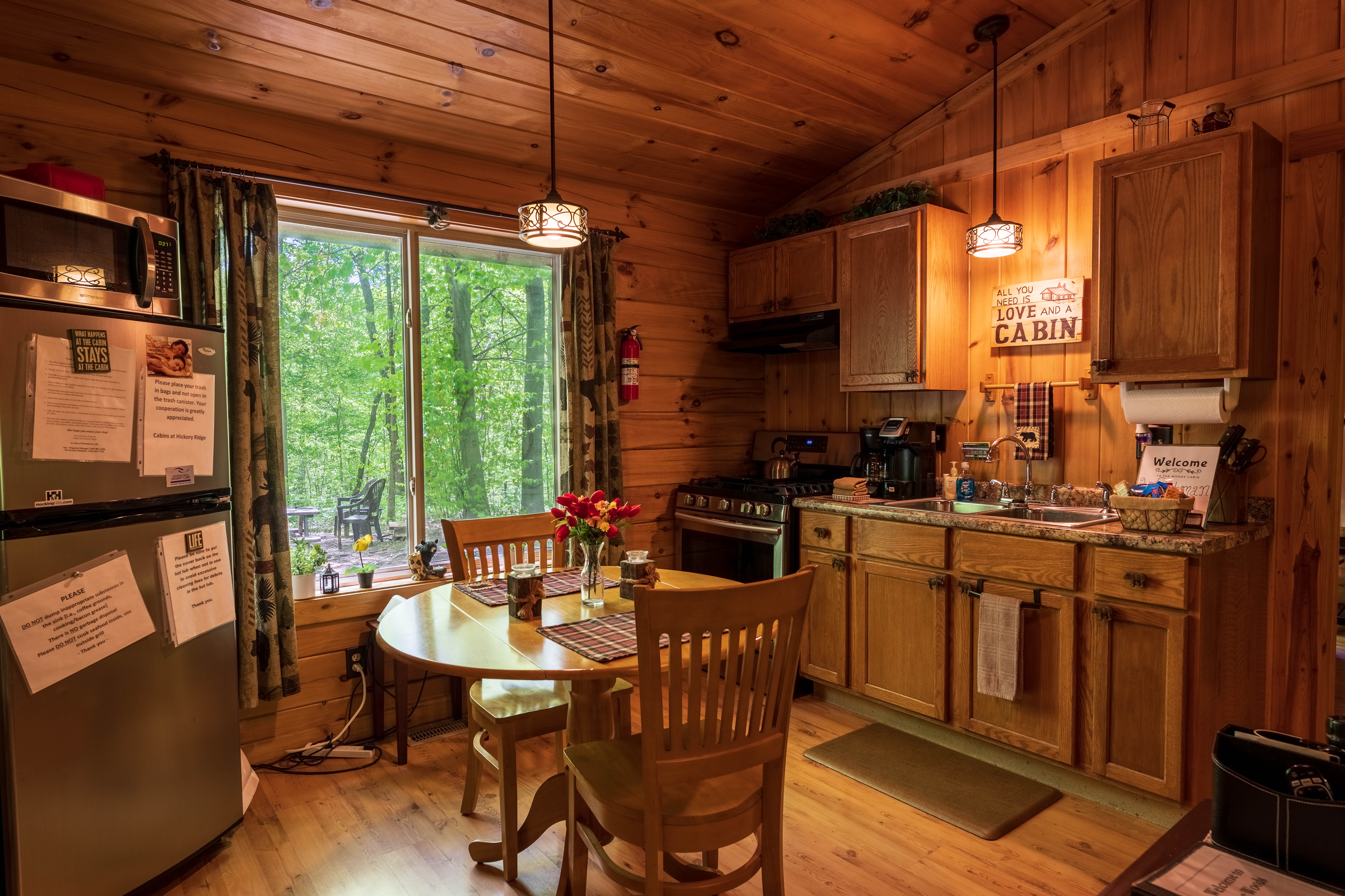 Photo 1407_10655.jpg - The cabin offers an open concept with the dining table and 2 chairs in the kitchen area.