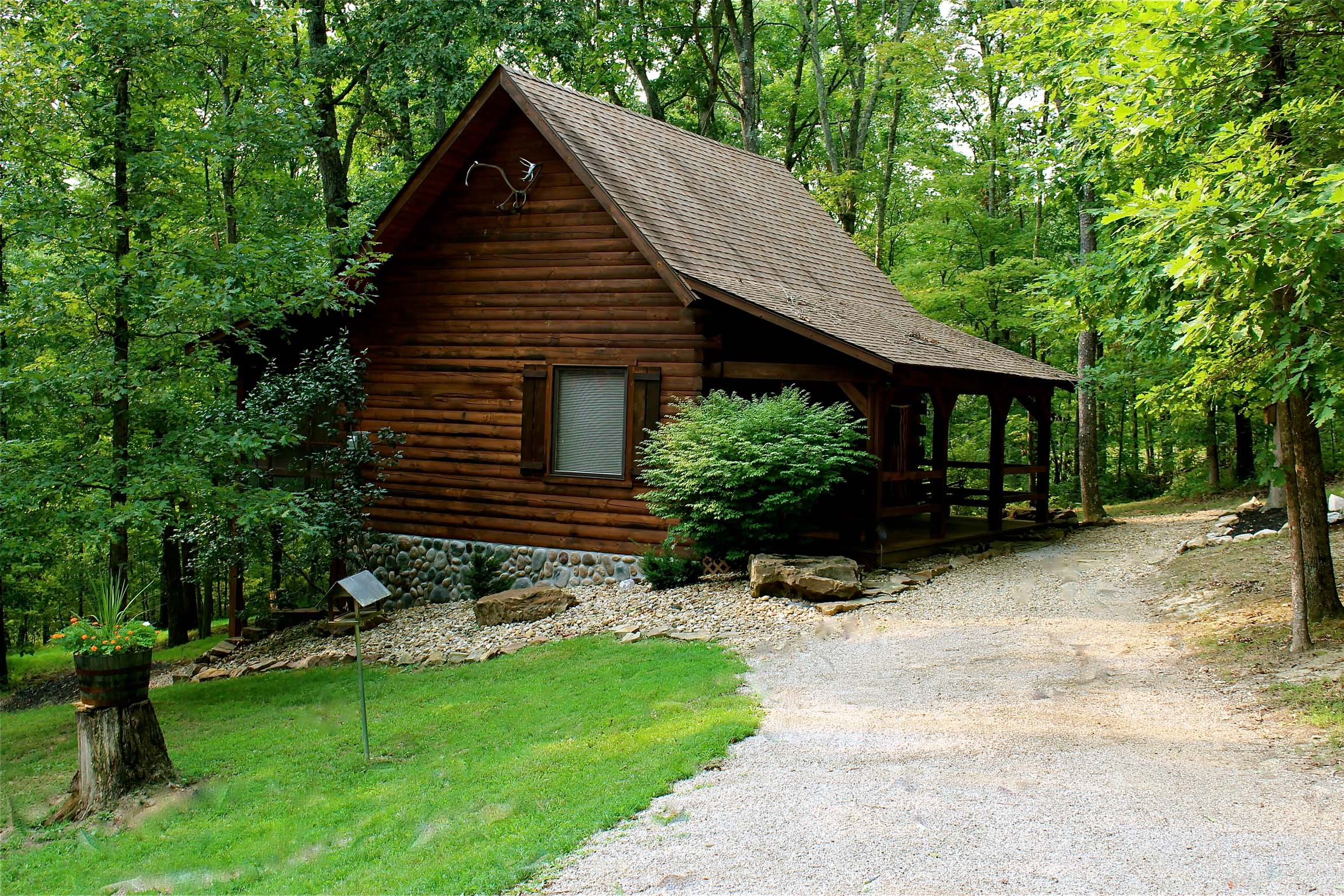 The Cardinal Cabin - This extraordinary log cabin is surrounded by lush woods and wildlife and located on a scenic and quiet country road.  A nearby fire ring is stock with free firewood for your convenience.