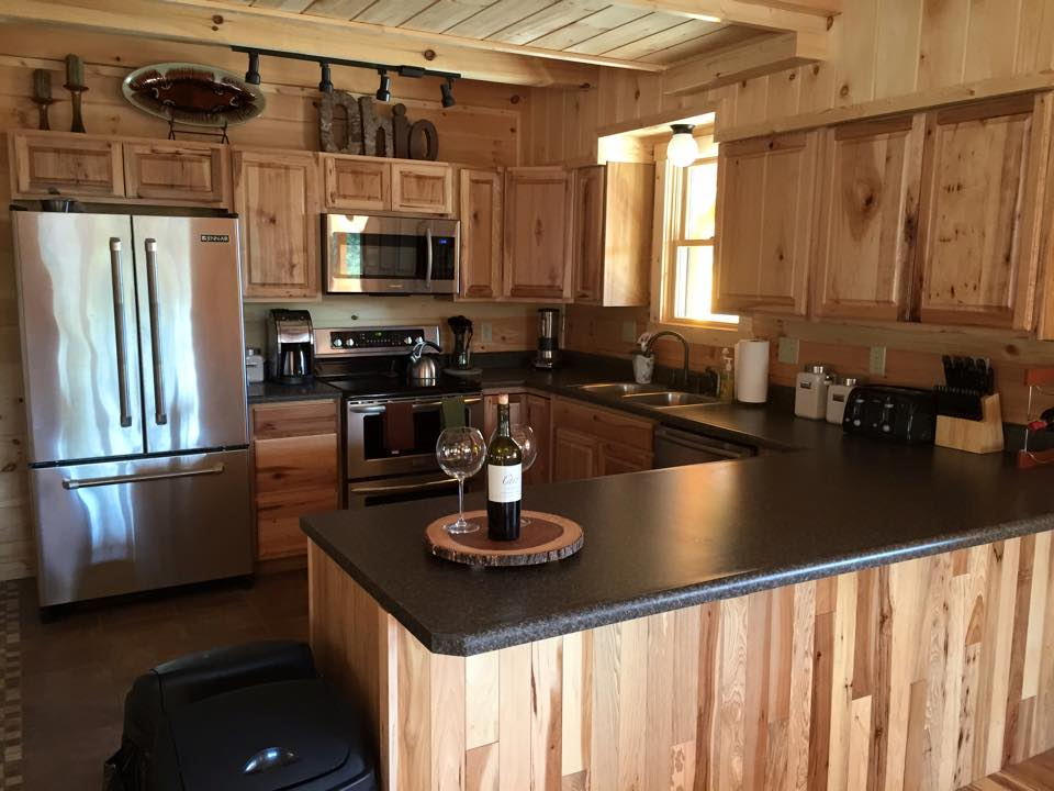 Kitchen at the Lodge - Fully stocked kitchen includes refrigerator, double ovens, electric range, microwave, toaster, and Bosch dishwasher.  Traditional 12-cup coffee maker. Just bring your ground coffee!