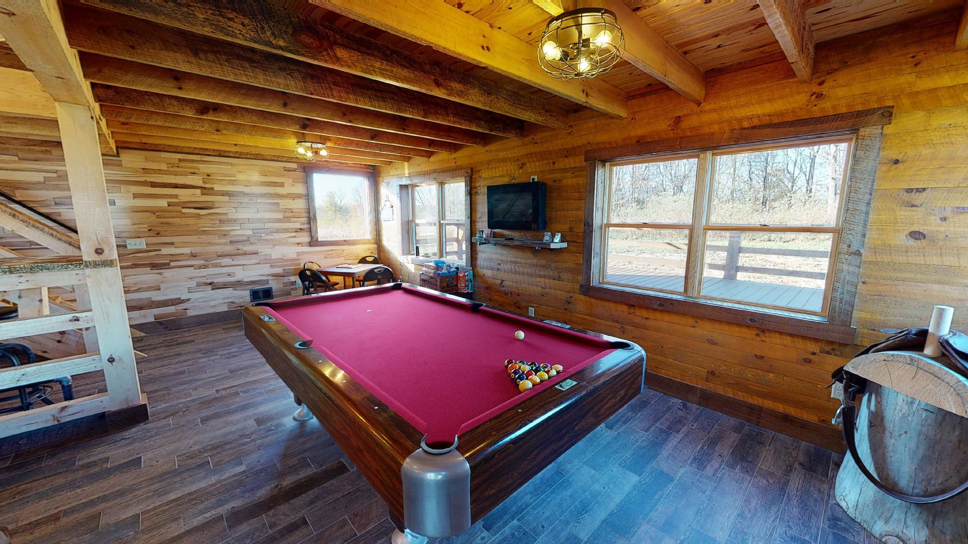 Photo 2006_9052.jpg - The Barn houses the vintage pool table. Along with croquet, board games, and more.