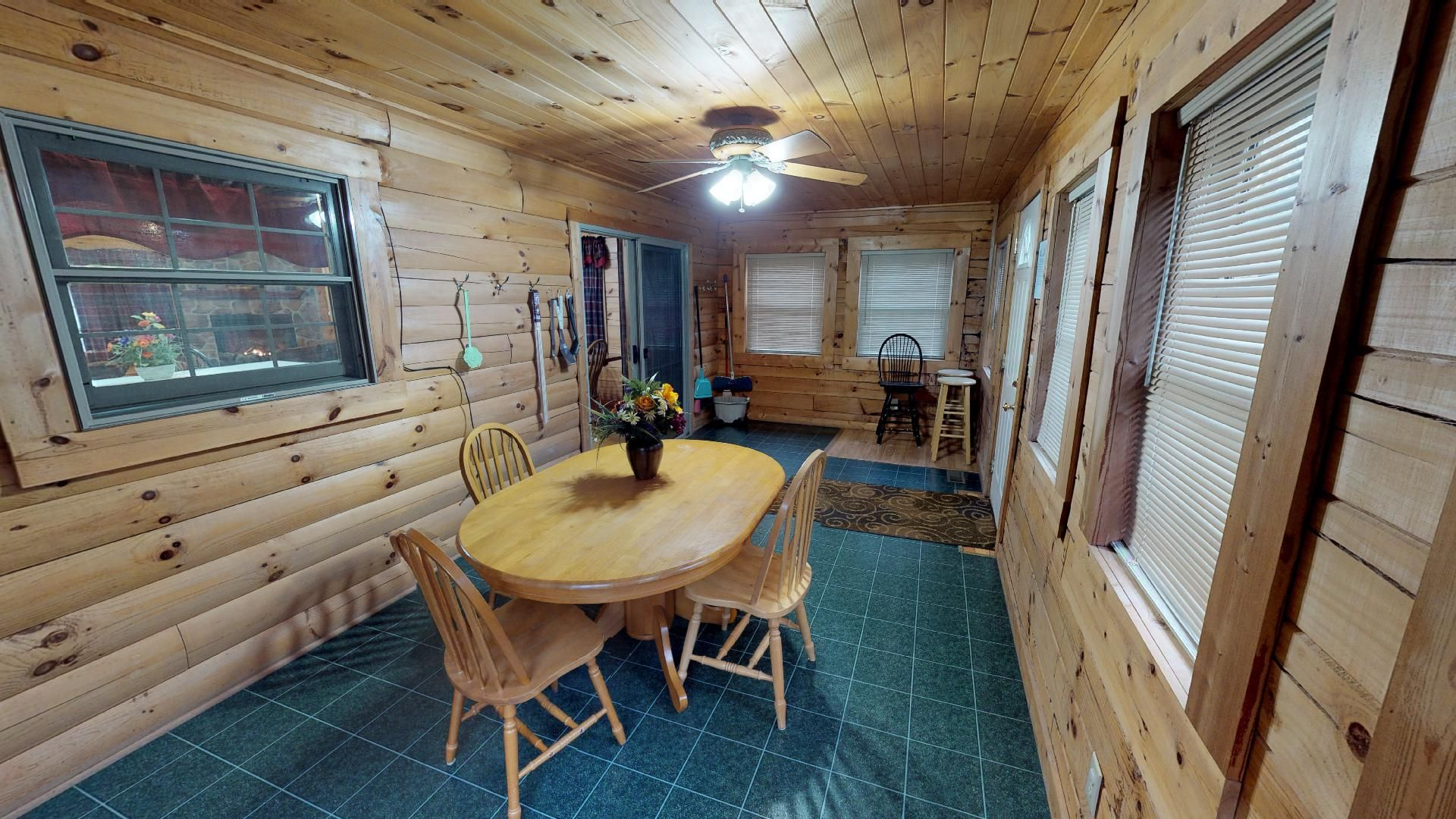 Sunrise 3 season Porch - Enjoy dining all the seasons in this enclosed porch area.
