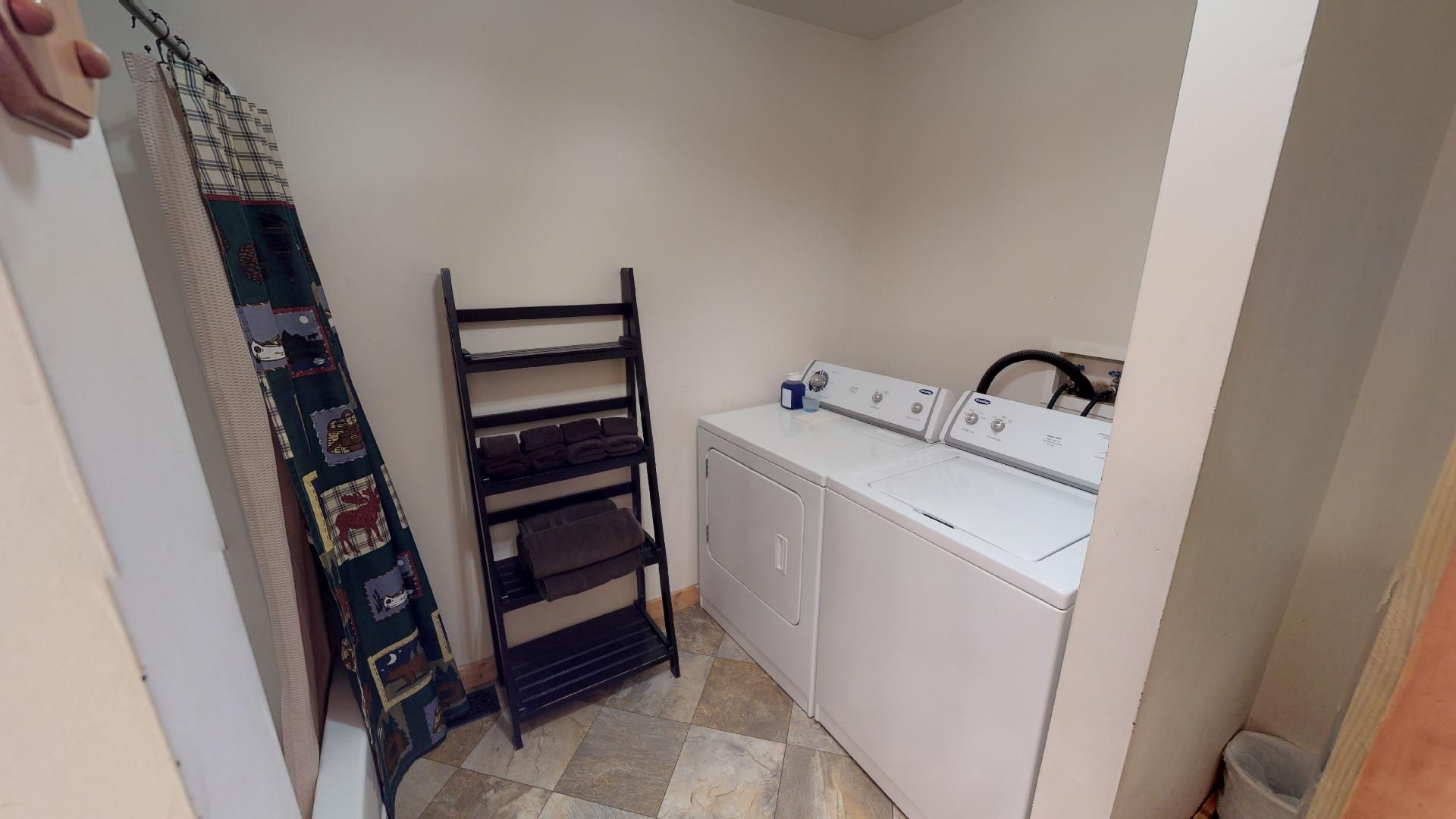 Sunrise Full Bathroom - Walk in shower and washer/dryer for guest usage.