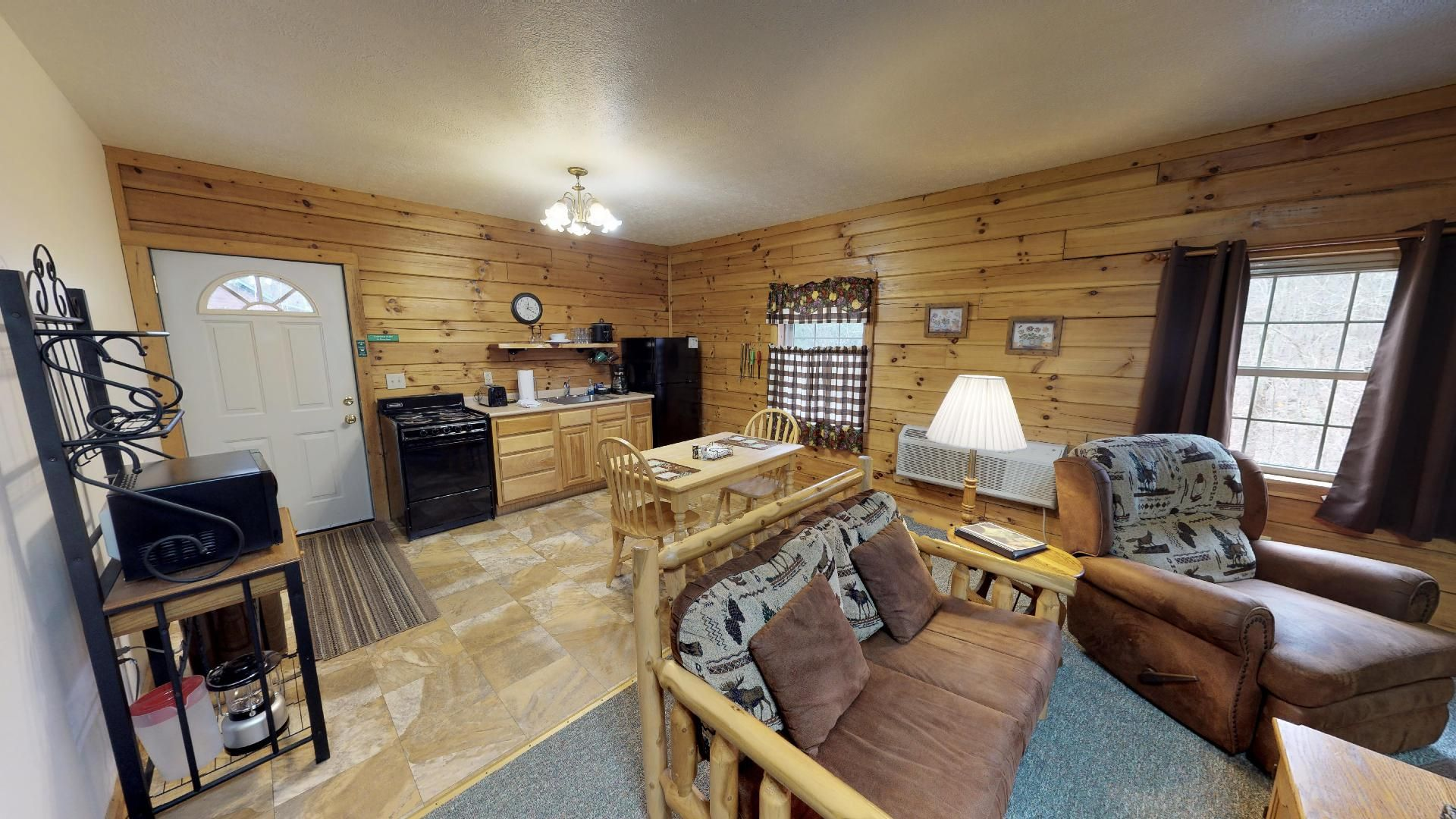 Briarwood Couples Cabin - Living room into kitchen.