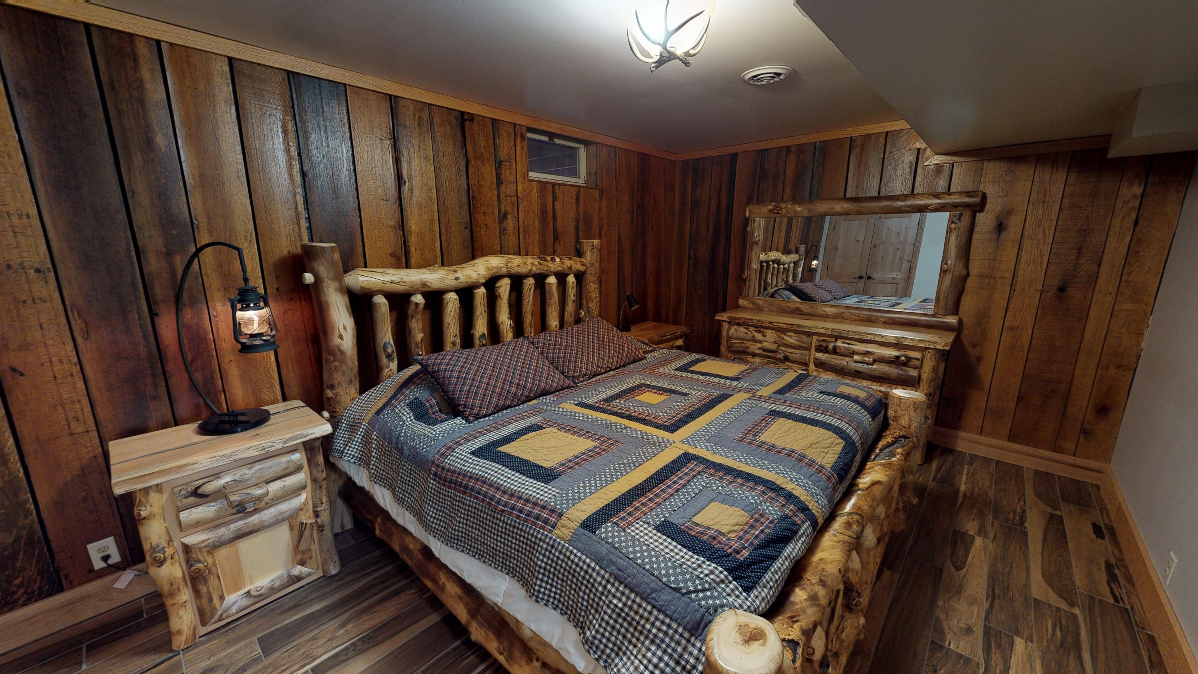 Photo 619_10242.jpg - One of three bedrooms that features log framed bed and matching dresser and night stand.