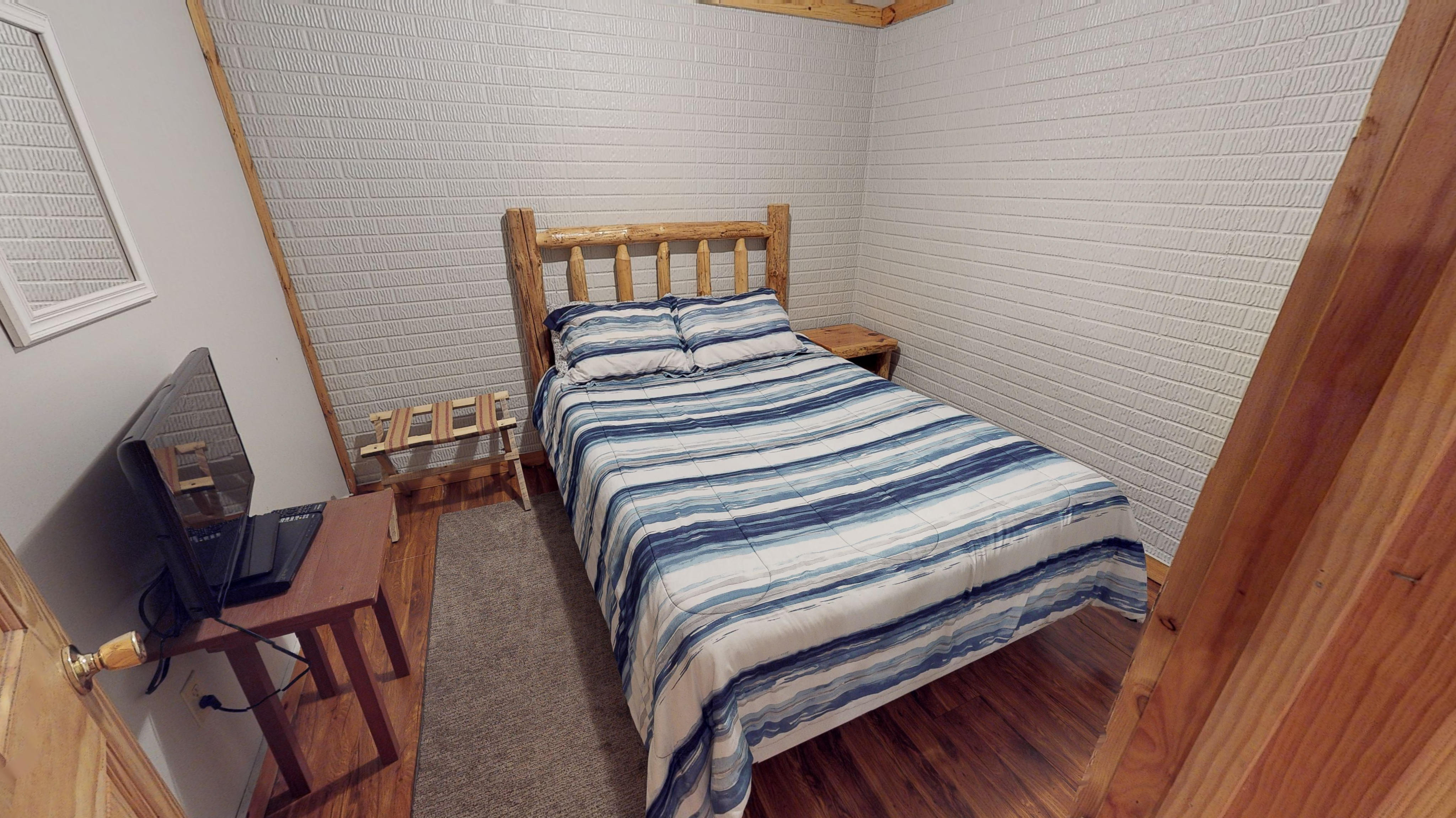 Photo 619_10255.jpg - Located on lower level, log queen bed