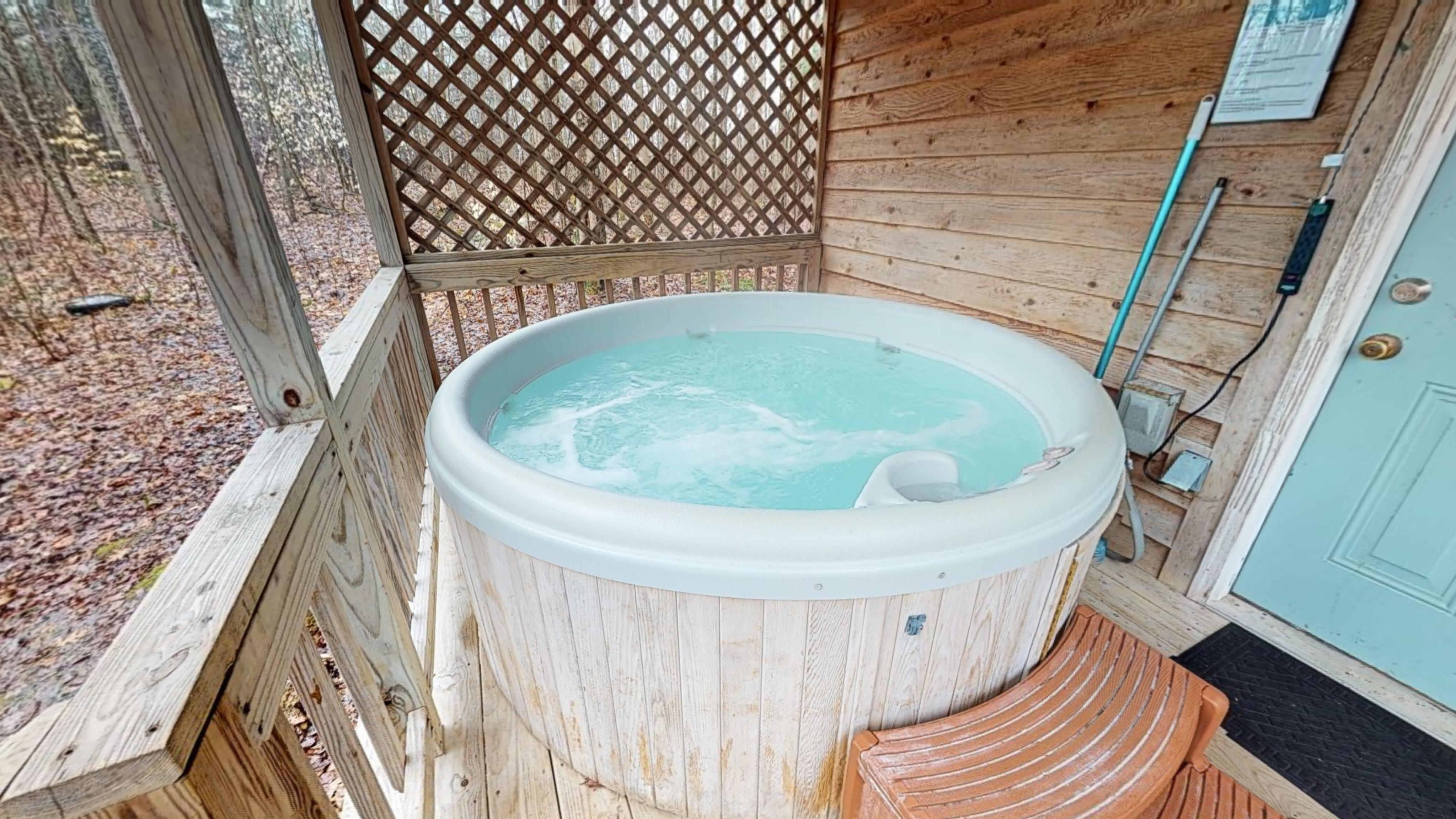 Photo 619_10272.jpg - the hot tub at Delaware Cabin is on the covered back porch and is completely secluded.  your view is of the fire pit and hollow below